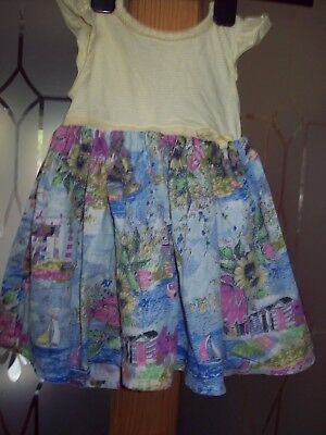 2 girls dresses, 1 monsoon and 1 bhs, 12-18 mts