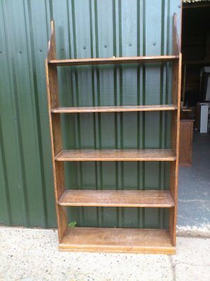 SOLID WOOD STAINED BOOKCASE, must be fitted to the wall as a little wobbly