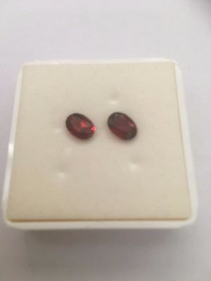 Lovely bright colour 2.04 ct oval cut Almandine Pyrope Garnet pair of gems