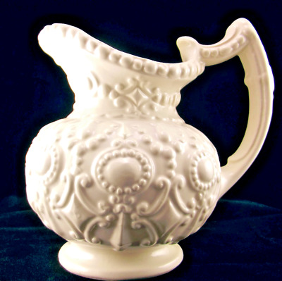 Camark Pottery ivory pitcher 139 C ornate Baroque embossed design USA