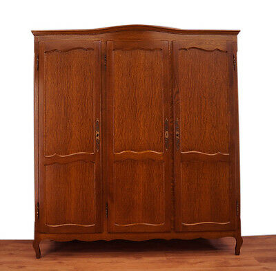Impressive French carved oak three doors wardrobe/armoire