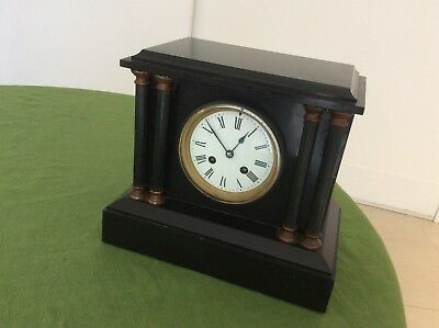 Fine antique slate mantel clock with striking mechanism.