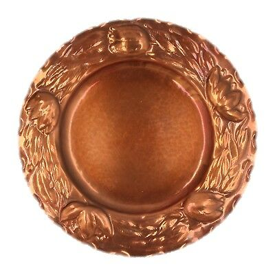 An Arts and Crafts copper dish Floral design Tulips Wall hung