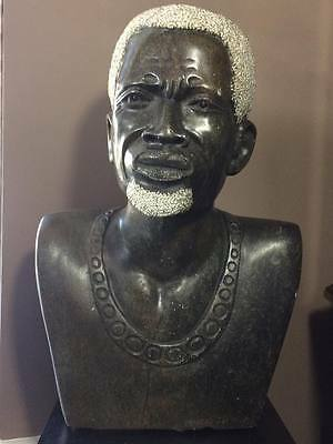 "Jepheus Makomo Brown Serpentine ""African King"" carving"