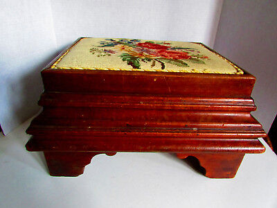 Antigue signed: A.H.B.B., needlepoint wooden footstool, rectangle nails used