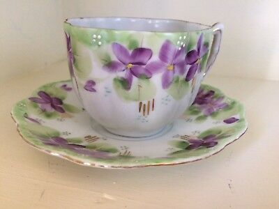 Stunning Hand painted Purple floral tea cup/saucer