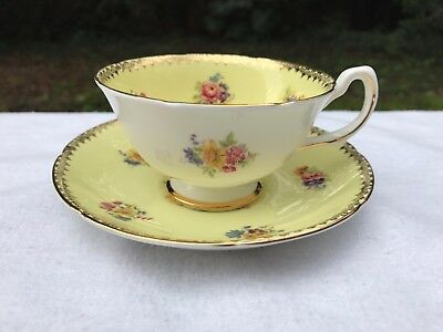 Gorgeous Royal Grafton Pale Yellow with Gold Trim Bone China Tea Cup and Saucer