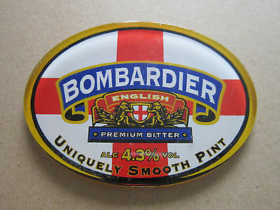 Wells Bombardier Plastic Oval T Bar Pump Badge