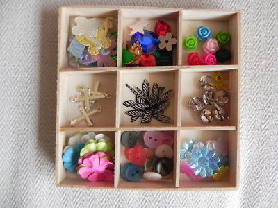 Small Scrapbooking Embellishments Kit in wooden tray