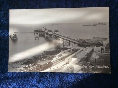 Printed Postcard of The Pier, Mumbles. - Train, Hancock' Advert, Sheds, Steamers