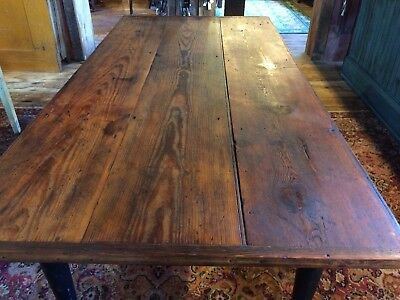 farm table from antique 1700s attic boards on top- black vintage repurposed base