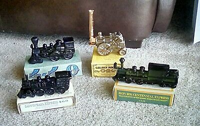 Lot of 4 Vintage Avon Collectible Bottles Trains full with box.