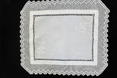 Vintage small white linen cloth with white crochet flowers.