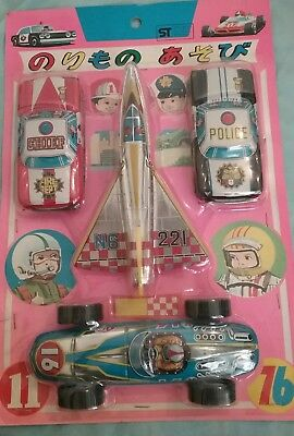 Four Tin Toys in Pack Made in Japan