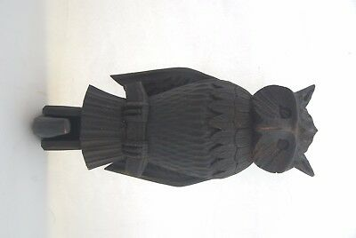 Carved wooden owl stained black with antomical wing movement