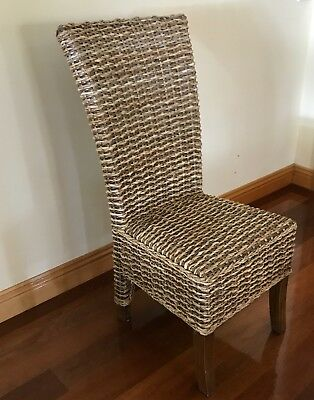 Balinese style high backed dinning chairs. 8 off