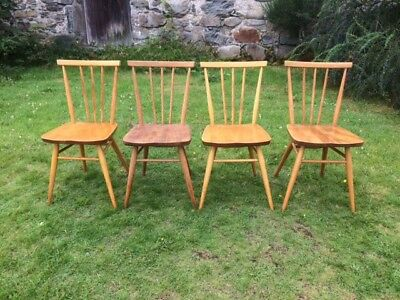 A Set of Four Ercol Dining Chairs
