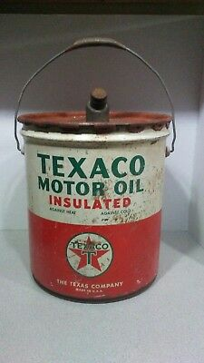 Texaco motor oil insulated 5 gallon can Wheeling 24 5 49. Nice spout and handle.