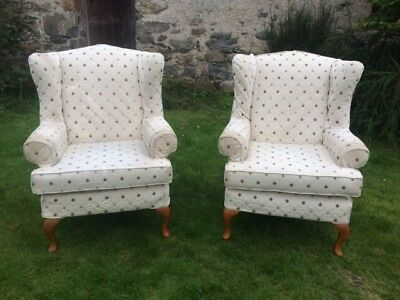 A Pair of Vintage Style Wing Back Armchairs