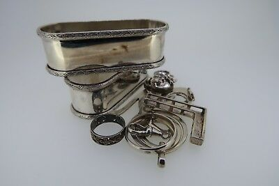 Sterling silver scrap lot, rings, pendants, charms, napkin rings etc 100.6 grams