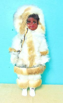Doll  wrapped in fur fishing pole boots gloves eskimo indian collection display