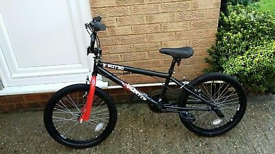 xrated quarter bmx bike black and red, virtually new!