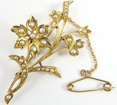 9ct yellow gold pearl set spray brooch. Weighs 3.7 grams. marked for 9ct gold.