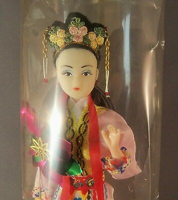 Vintage Chinese Doll in Traditional Dress Attached to Base