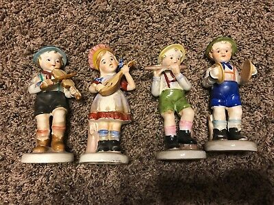 Vintage hand painted children figurines made in Japan