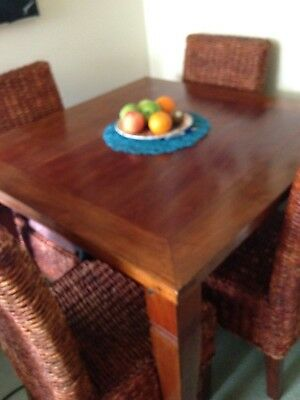 dinner wooden table with 4 high back rattan chairs