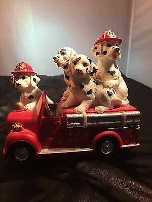 Music Box Firetruck With A Bunch Of Dogs