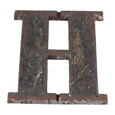 A late 19th - early 20th century cast iron H shop sign Architectural Typography
