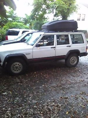 1995 Jeep Cherokee Black 1995 Jeep Cherokee Runs great! Brand new radiator and water pump. Cargo top too!