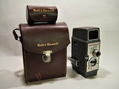 Vintage Bell and Howell Two Twenty 8 mm Movie Camera & film, extra case & lenses