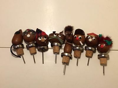 8 Mixed mid century teak bottle stoppers