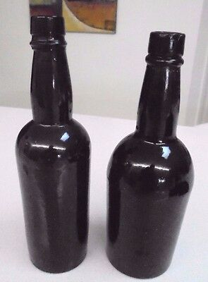 Black Beer Bottles x 2 -  one bottle has F Coutts & Son embossed to base vintage