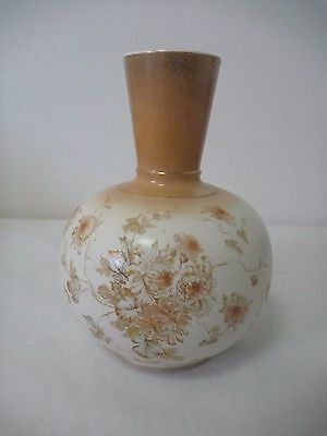 Antique Vase with floral decoration and sponged gold top.