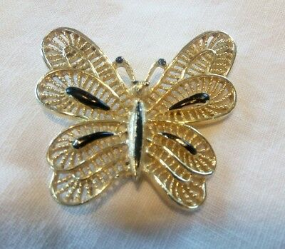 Vintage gold tone metal butterfly pin brooch  with black