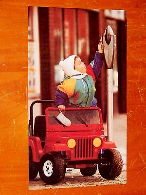Picture Kid In Mini Motorized Jeep Wrangler Feeding Parking Meter From 1990 Mag.