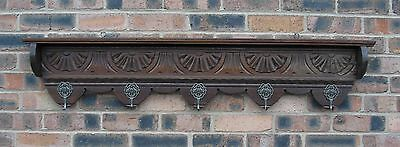 Antique 19th century carved oak frieze supporting five cherub mounted hooks