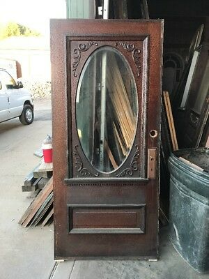 An 002 Antique Beveled Oval Oak Gingerbread Entrance Door 35.5 X 79.5
