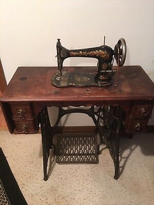 1901 Antique Singer Treadle Sewing Machine with Oak Cabinet.