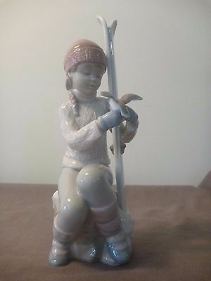 Lladro girl with skis.  'Take a Breath' #8323