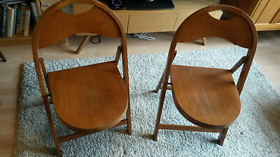 Pair of vintage wooden folding cafe chairs