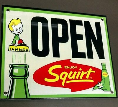 """Squirt soda pop .... Sign ...12"""" wide"""