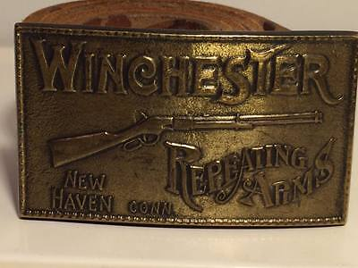 1970's Winchester Repeating Arms brass belt buckle and hand tooled leather belt