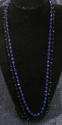 Wonderful long strand of faceted bead with half Black & half Purple Goth dream!