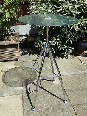 Tall glass bistro table