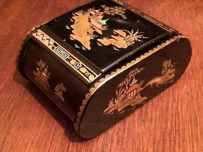 Tabacco tin case is from the late 1940s early 50's