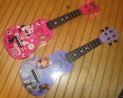 "Lot of (2) Disney First Act 20.5"" Ukulele Guitars Minnie Mouse & ""Sofia The 1st"""